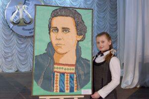 Anna Cherkasenko and her competition work - a portrait of Lesya Ukrainka, made of plasticine