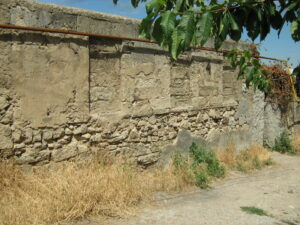 What are the ruins of the Karaite settlement silent about?
